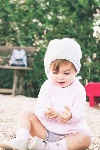 Child Childhood Baby Innocence Real People One Person Young Cute Focus On Foreground Sitting Babyhood Front View Women Toddler  Lifestyles Day Females Outdoors Park Playful Springtime Happiness