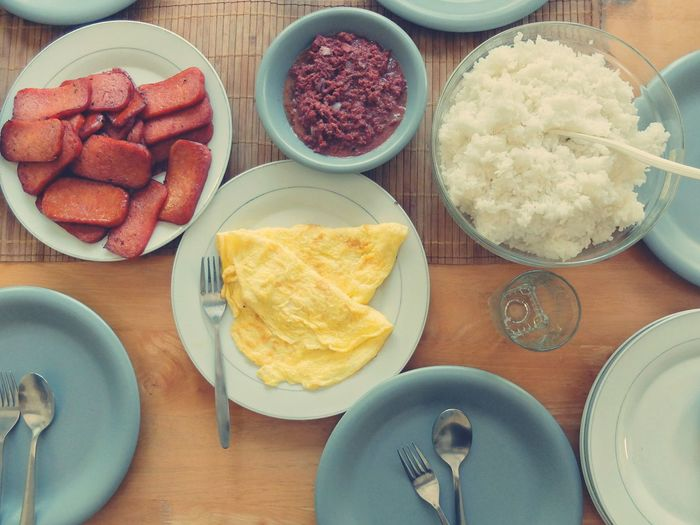 Directly Above Shot Of Rice With Omelet On Dining Table