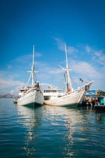 Boats in Labuan Bajo Indonesia Indonesia Boat Boat Labuan Bajo Nautical Vessel Transportation Mode Of Transportation Water Sailboat Sky Sea Blue Sailing Sailing Ship Waterfront Nature Day Mast Travel Pole Ship No People Moored Outdoors Yacht Luxury Passenger Craft Anchored Turquoise Colored