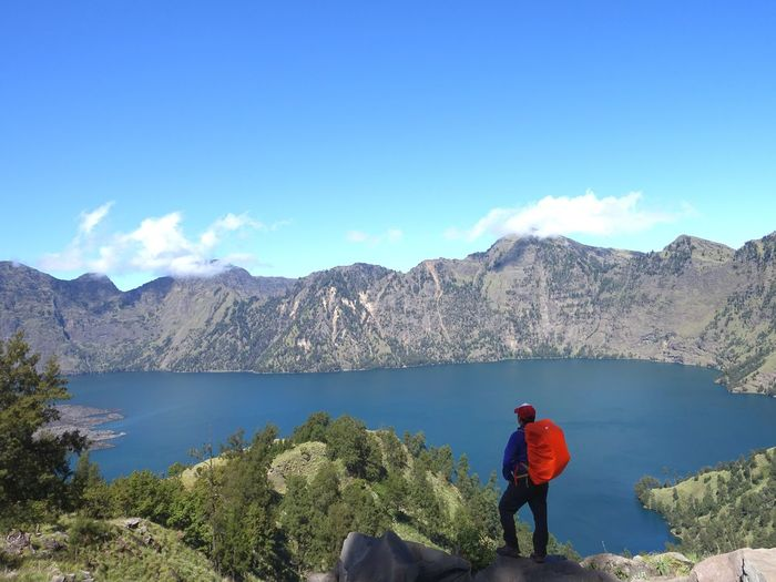 super view Lake View Rest Water Mountain Full Length Adventure Lake Standing Hiking Blue Men Backpack Volcanic Landscape The Natural World Active Volcano Volcanic Crater Hiker East Java Province Java