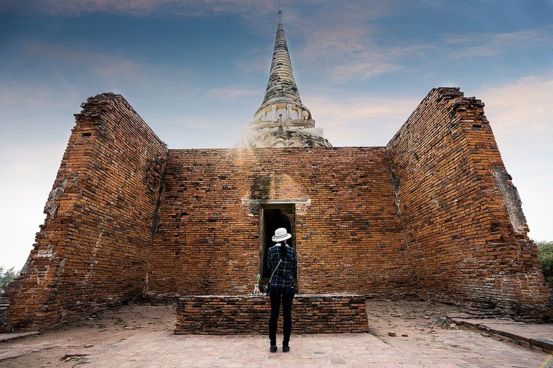 Full length rear view of woman standing at temple