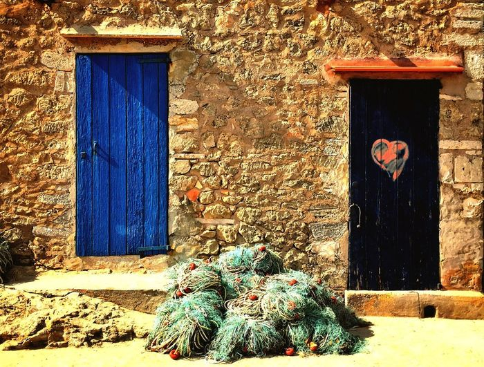 Wall Stone Blue Heart ❤ Heart Shape Heart Love Wood Net Fishing Island Outdoor SPAIN Door Architecture Building Exterior Built Structure Day No People Outdoors EyeEmNewHere Business Stories The Graphic City The Still Life Photographer - 2018 EyeEm Awards