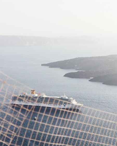 Sea High Angle View Water No People Day Aerial View Outdoors Scenics Tranquility Building Exterior Architecture Nature Built Structure Horizon Over Water Beauty In Nature Sky Santorini Santorini, Greece Imerovigli EyeEmNewHere