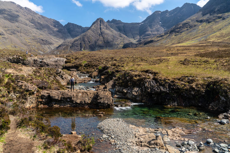 Fairy Pools Scotland Adventure Beauty In Nature Day Environment Isle Of Skye Landscape Leisure Activity Mountain Mountain Range Nature Non-urban Scene Outdoors Real People Rock Rock - Object Scenics - Nature Sky Solid Tranquil Scene Tranquility Water Waterfall The Great Outdoors - 2018 EyeEm Awards The Traveler - 2018 EyeEm Awards The Portraitist - 2018 EyeEm Awards