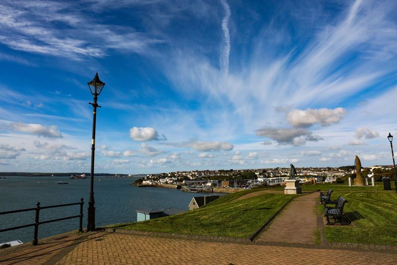 A small walk in the sunshine anywhere is a great tonic. Cloud - Sky Sky Water Architecture Nature Built Structure Street Incidental People Street Light Building Exterior Sea Beauty In Nature Lighting Equipment Day Footpath Scenics - Nature Outdoors Grass