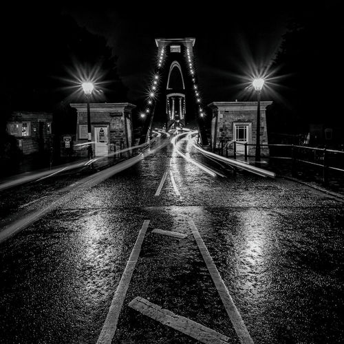 Nighttime Rain Road Traffic Architecture Bridge Bridge - Man Made Structure Building Building Exterior Buildings Built Structure Illuminated Lighting Equipment Night No People Outdoors Rian Days Shadows Sky Street Light Suspension Bridge The Way Forward Transportation Water