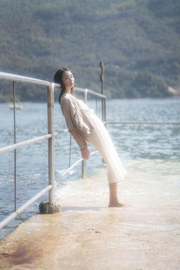 Woman standing at seaside