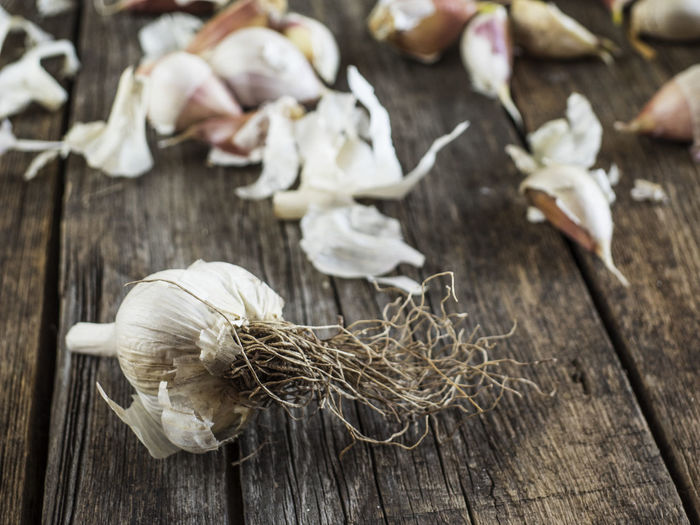 Close-Up Of Garlic On Wooden Table