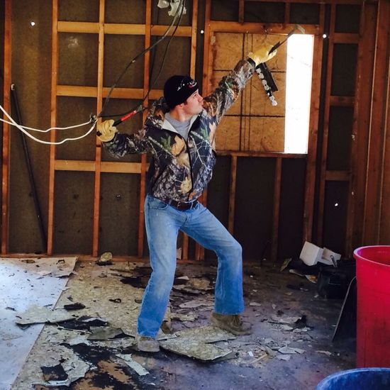 Camo Construction Single Full Length Casual Clothing Lifestyles Leisure Activity Person Young Adult Young Women In Front Of Day Domestic Life Thoughtful Mature Adult Work Renovation Rehab Flipping Houses HERO Superhero Pose Hulk HulkHogan Hulkster