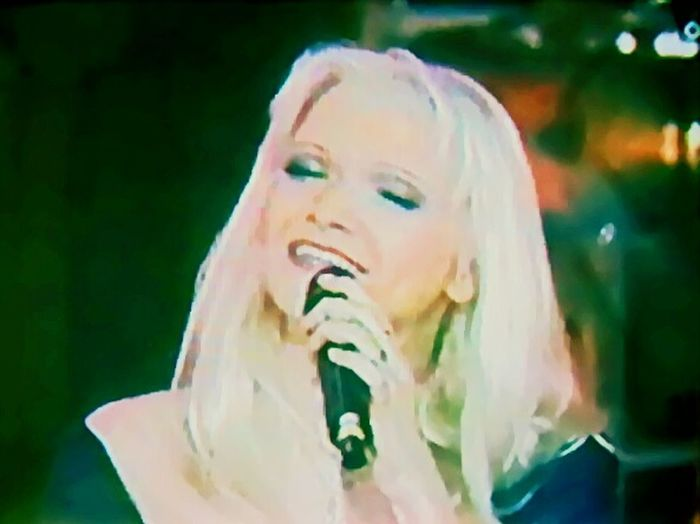 Capture The Moment Me, singing on a TV show...