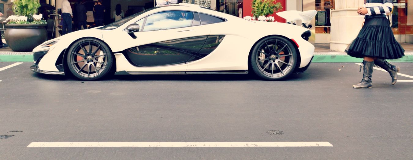 """McLaren P1 at Santana Row"" video is up on Youtube. McLaren Mclaren P1 Luxury Car in front of Tesla store."