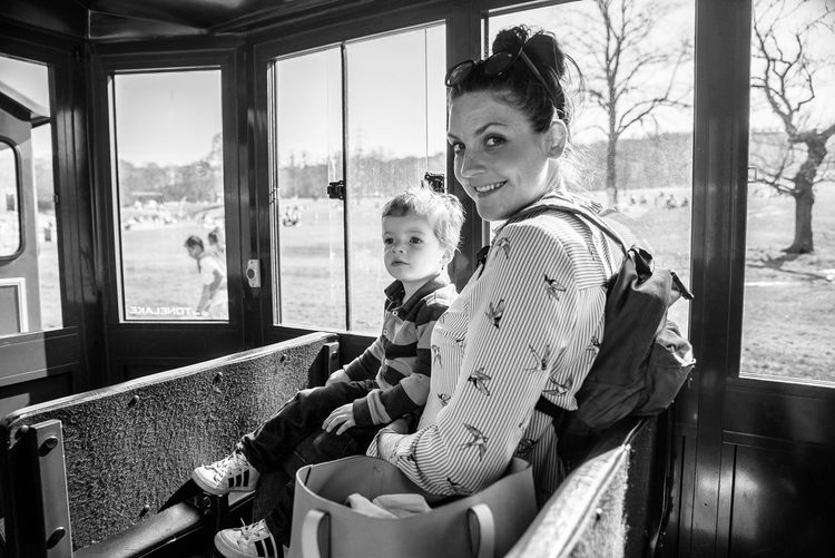 Portrait of mother sitting with son in bus