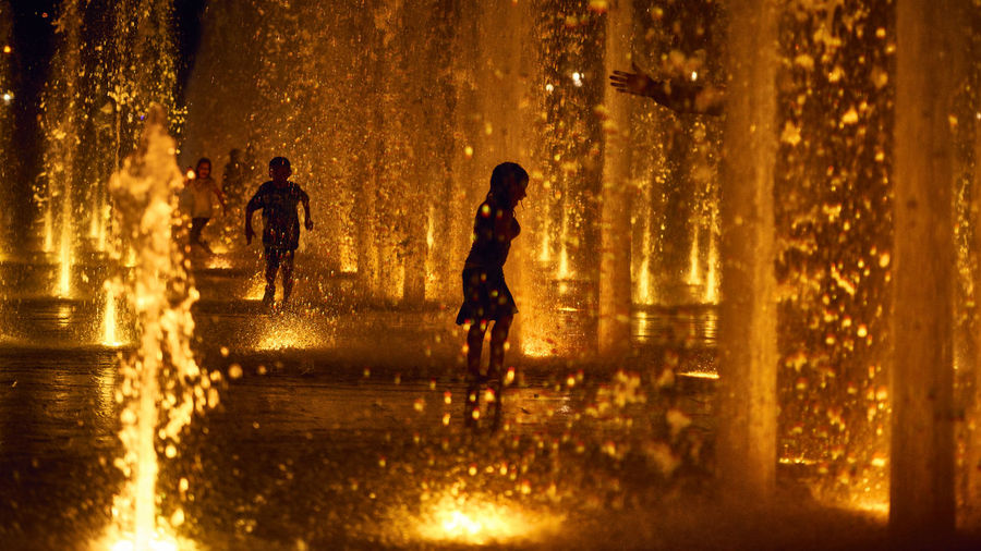 Play gold Children Colored Colors Fountain Gold Child Childhood Full Length Night Outdoors People Play Silhouette Streetphotography Water Wet Yellow