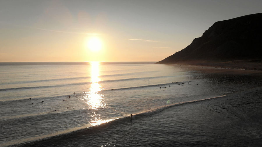 Arctic surfing at Unstad Beach, Norway! Surfers Sports Fun Sunset By The Sea By The Sea Swimming Birds Eye View View From Above Droneshot Drone  Outdoors Sunlight Beach Sea Mountain Idyllic Reflection Waves Sunset Horizon Over Water Lofoten Surfing Arctic Aerial View Mavic Air