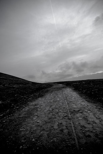 Cloudy Footprints Beauty In Nature Bicycle Track Blackandwhite Photography Landscape Nature No People Sky The Way Forward Tranquil Scene
