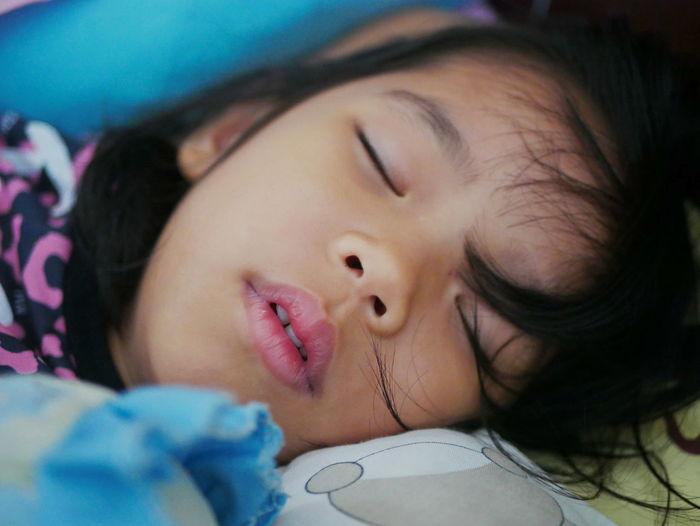 Portrait of cute girl sleeping in bed