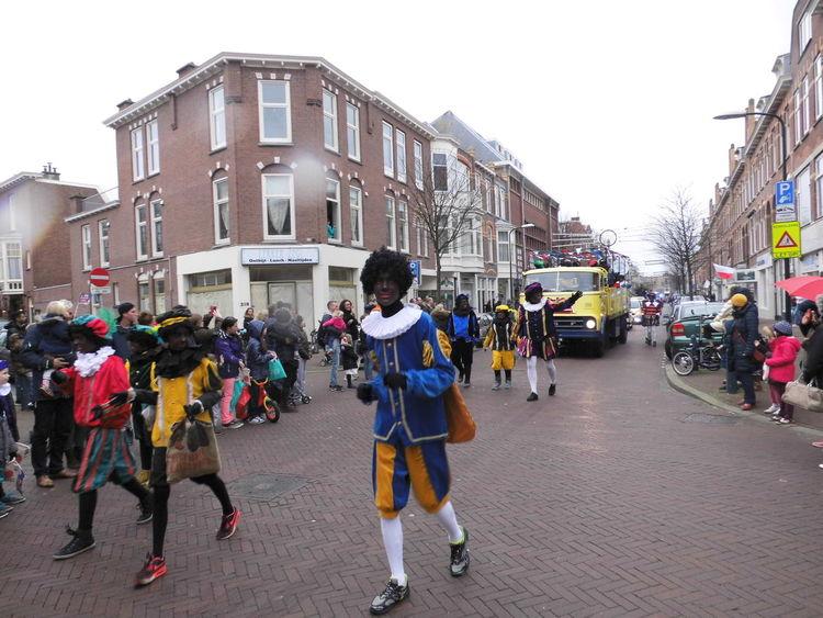 Architecture City City Life Cultures Dutch Culture Lifestyles Mode Of Transport Real People Road Sinterklaas St Nicolas Street Streetphotography Transportation Walking Zwarte Piet