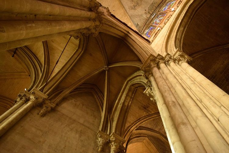 Paris cathedral Stone Dramatic Gothic Arch Light And Shadow Low Angle View Paris EyeEm Selects Architecture History Indoors  Low Angle View Religion Architectural Column Place Of Worship Built Structure Travel Destinations