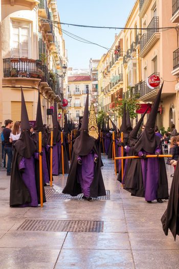 People in the procession in the Holy Week (Semana Santa) in a Spanish city. Malaga, Spain - March 26, 2018. Catolic Church Children Easter Easter Ready Historical Building Holy Week Malaga People Watching SPAIN Semana Santa Spanish Uniform Uniforms Adult Architecture Building Exterior Built Structure Catolicism Celebration City Clothing Crowd Day España Group Of People Large Group Of People Leisure Activity Lifestyles Men Musical Instrument Musician Musician Bands Old Buildings Outdoors Procession Real People Sabor Spain Is Different Spanish Arquitecture Spanish Culture Street Traditional Clothing Walking Adventures In The City The Street Photographer - 2018 EyeEm Awards The Traveler - 2018 EyeEm Awards