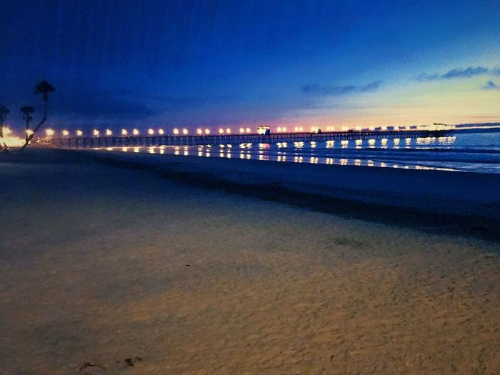 City Of The O Oceanside, Ca Pier Water Sea Sky Beach Land Nature Scenics - Nature Night Beauty In Nature Illuminated Tranquil Scene Blue Sand Tranquility Dusk Outdoors Idyllic City