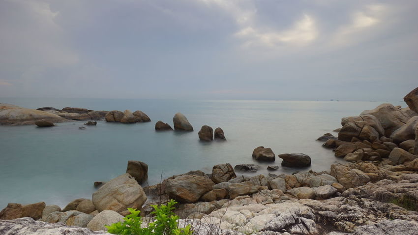 Pantai Batu Berbaris, Parai Tengiri, Sungailiat Bangka. Pantai Granitic Boulder Granitic Beach Travel Photography Like Rocky Beach Seascape Seaview Cloudy Day Bangka Scenic Photography By @jgawibowo Arif Wibowo Photoworks Shot By @jgawibowo Shot By Arif Wibowo Sea Beach Water Tranquility Rock - Object Scenics Tranquil Scene Nature Beauty In Nature Travel Destinations Landscape