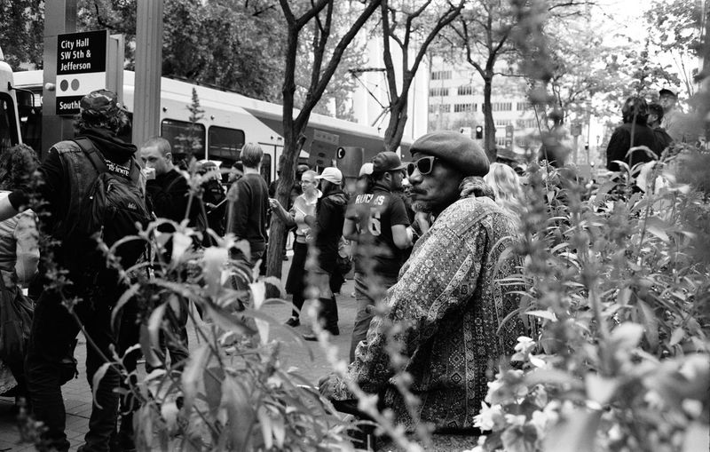 Black Lives Matter Protest in Portland Oregon. When the protests were still peaceful. Well as peaceful as angry masses generally are... 35mm Film Adult Ahp Angelaholmphotography Black And White Black Lives Matter Blackandwhite City Day Documentary Photography Film Photography Large Group Of People Leica Men Outdoors People Police Portland Protest Real People Riot, Side View Snap a Stranger Streetphotography The Week On EyeEm The Street Photographer - 2017 EyeEm Awards The Photojournalist - 2017 EyeEm Awards