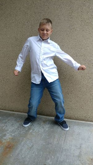 boy can dance Dancing In The Street Jeans Snd Button Down Lexington KY Happiness Blond Hair And Blue Eyes 11 Year Old Boy Loves To Dance Natural Talent Bust A Move Silly Face Styling Kid Full Length Child Males  Boys Portrait Childhood Standing Casual Clothing Jeans Canvas Shoe Footwear Urban Fashion Jungle Be Brave