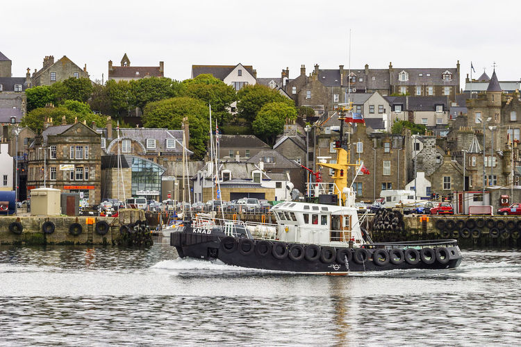 Tugboat on the way in lerwick harbor