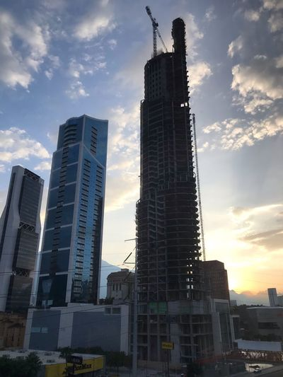 Architecture Building Exterior Built Structure Sky Office Building Exterior City Cloud - Sky Nature Travel Destinations Low Angle View No People Development Outdoors Office Modern Sunset Tower Skyscraper Tall - High Building