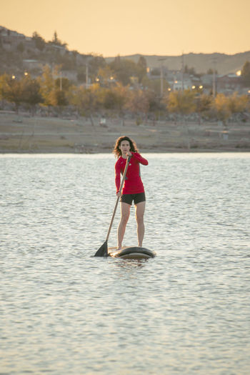 Full length portrait of woman standing in lake