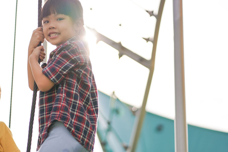 Asian little girl playing at playground Portrait Asian  Girl Cute Playground Child Wireless Technology Childhood Smiling Happiness Teenager Standing Cheerful Learning Casual Clothing Preschooler