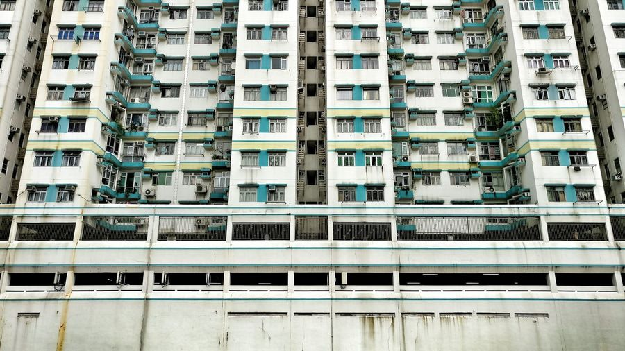 Before it is gone. Building Facades Repitition Density Stacked White Wall Housing Massive Buildings Old Urban Colour Of Life Tsuen Wan Eyeemphoto EyeEm Gallery