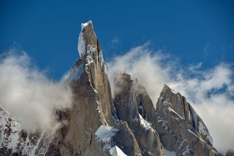 Famous mt. cerro torre against clear blue sky in los glaciares national park