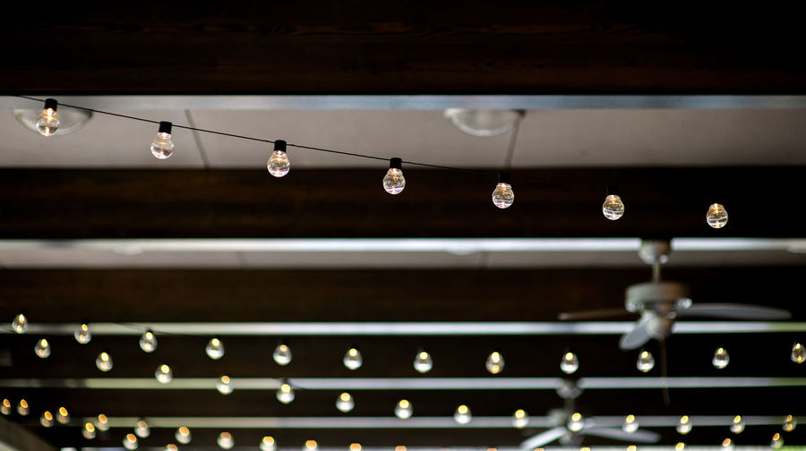Retro light bulbs hanging in department store, with decorate interior luxury