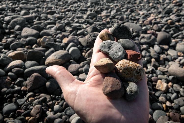 Human hand on rock