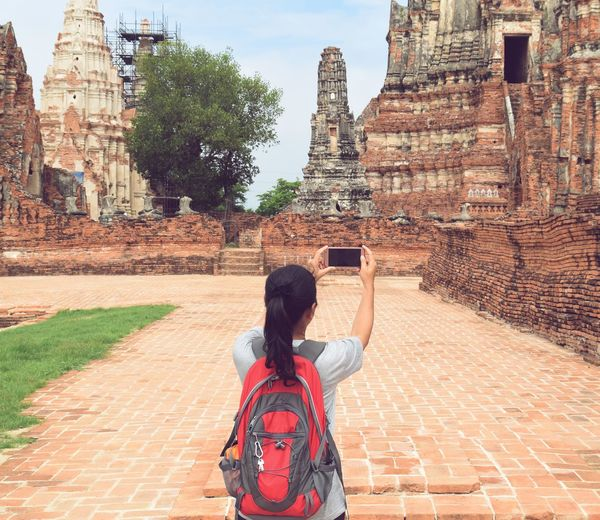 women photographing at historical park in Ayutthaya historical park View Copy Space Lifestyles Traveler Traveling Vocation Women People Famous Place Photographing Visiting Trip ASIA Thailand Ayutthaya | Thailand Smartphone Tourism Ancient Civilization Place Of Worship Spirituality City Religion Ancient Old Ruin History Architecture Building Exterior Visiting Monument Pagoda