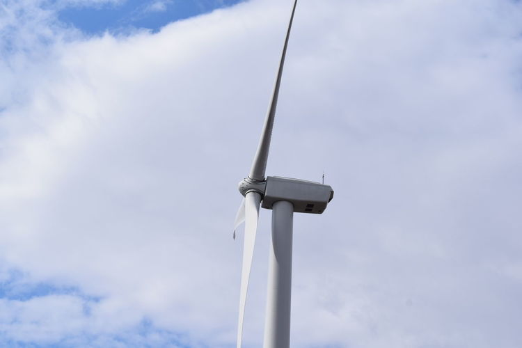 Wind Power in Northwestern Indiana Alternative Energy Cable Cloud - Sky Day Electricity  Environmental Conservation Fuel And Power Generation Low Angle View Nature No People Outdoors Power Supply Renewable Energy Sky Technology Wind Turbine