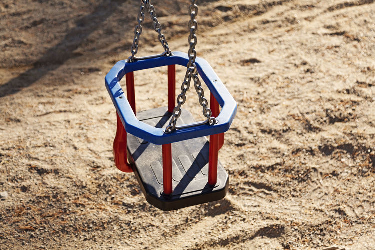 Close-up of swing in playground