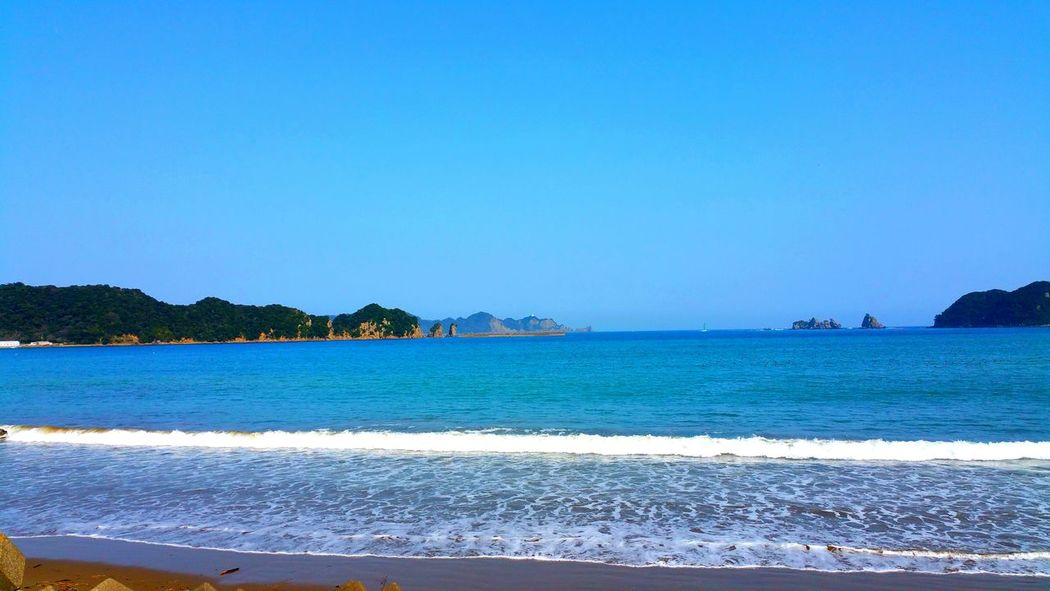 Water Blue Sea Copy Space Clear Sky Scenics Beach Tranquil Scene Tranquility Beauty In Nature Seascape Calm Shore Nature Wave Coastline Mountain Day Vacations Ocean Nature
