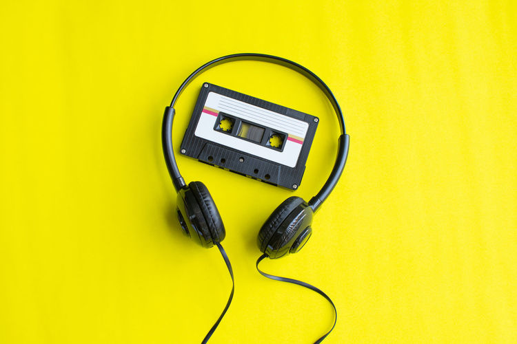 Tape Cassette Old Vintage Retro Connection Indoors  Technology Yellow Cable Colored Background Listening Studio Shot Music Headphones Close-up Communication Electricity  No People Electric Plug Equipment Time Number High Angle View Fuel And Power Generation Clock Power Supply