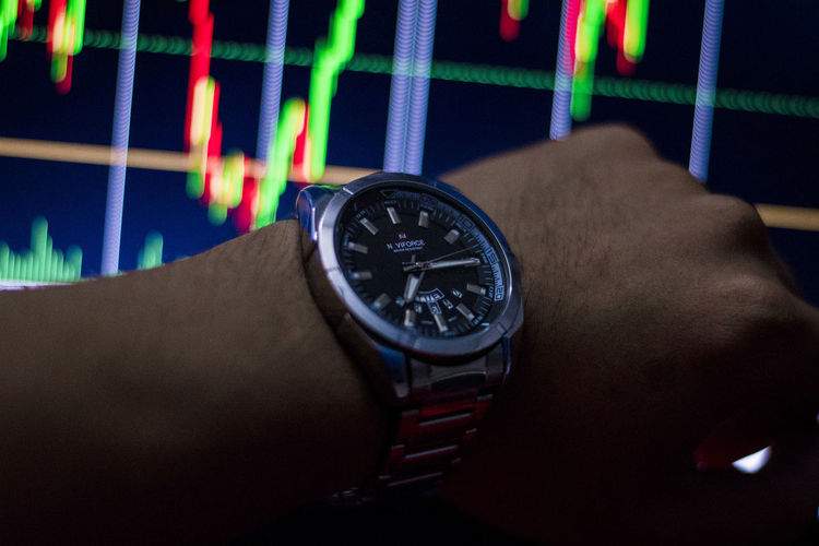 See stock chart time See Stock Chart Time Human Hand Hand Human Body Part One Person Real People Watch Wristwatch Lifestyles Time Body Part Indoors  Men Close-up Unrecognizable Person Leisure Activity Human Finger Finger Personal Perspective Holding Human Limb