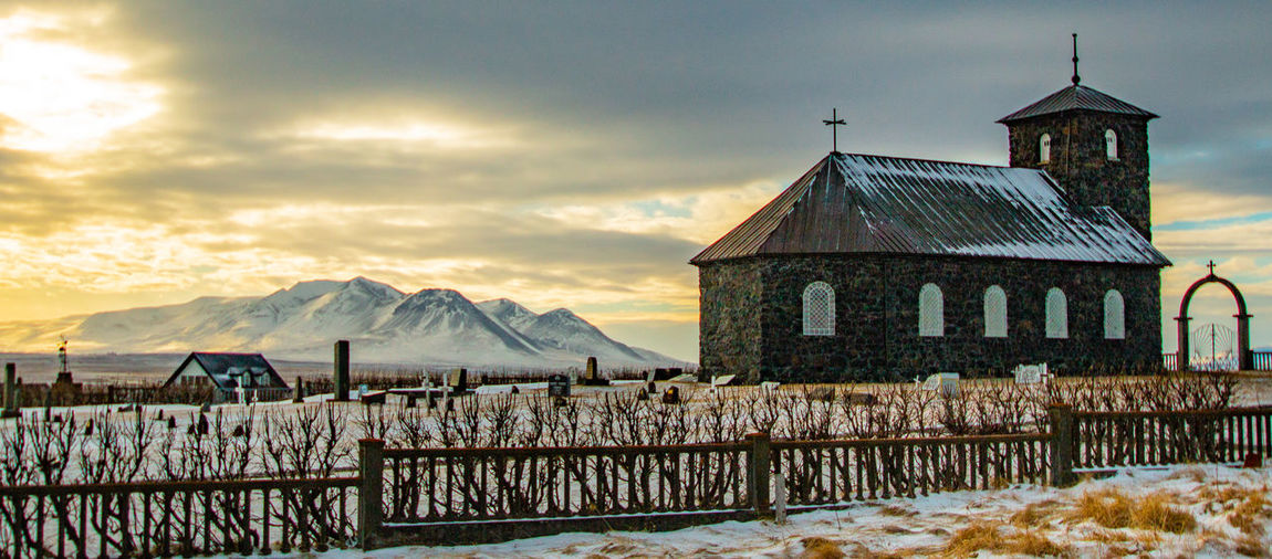Pingeyrar Church at Dawn Church Jason Gines Pingeyrar Church Architecture Building Building Exterior Built Structure Cloud - Sky Cold Temperature Fence House Mountain Nature No People Outdoors Scenics - Nature Sky Snow Snowcapped Mountain Sunset Tranquil Scene Tranquility Travel Destinations Water Winter My Best Photo