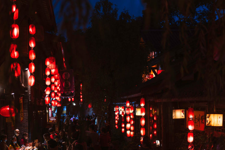 Chinese red lanterns, nightlife China Landscape Blessing Wishing Chinese Culture Lantern Night Illuminated Lighting Equipment Building Exterior Architecture City Large Group Of People Decoration Group Of People Crowd Tree Outdoors Chinese Lantern Light Nightlife