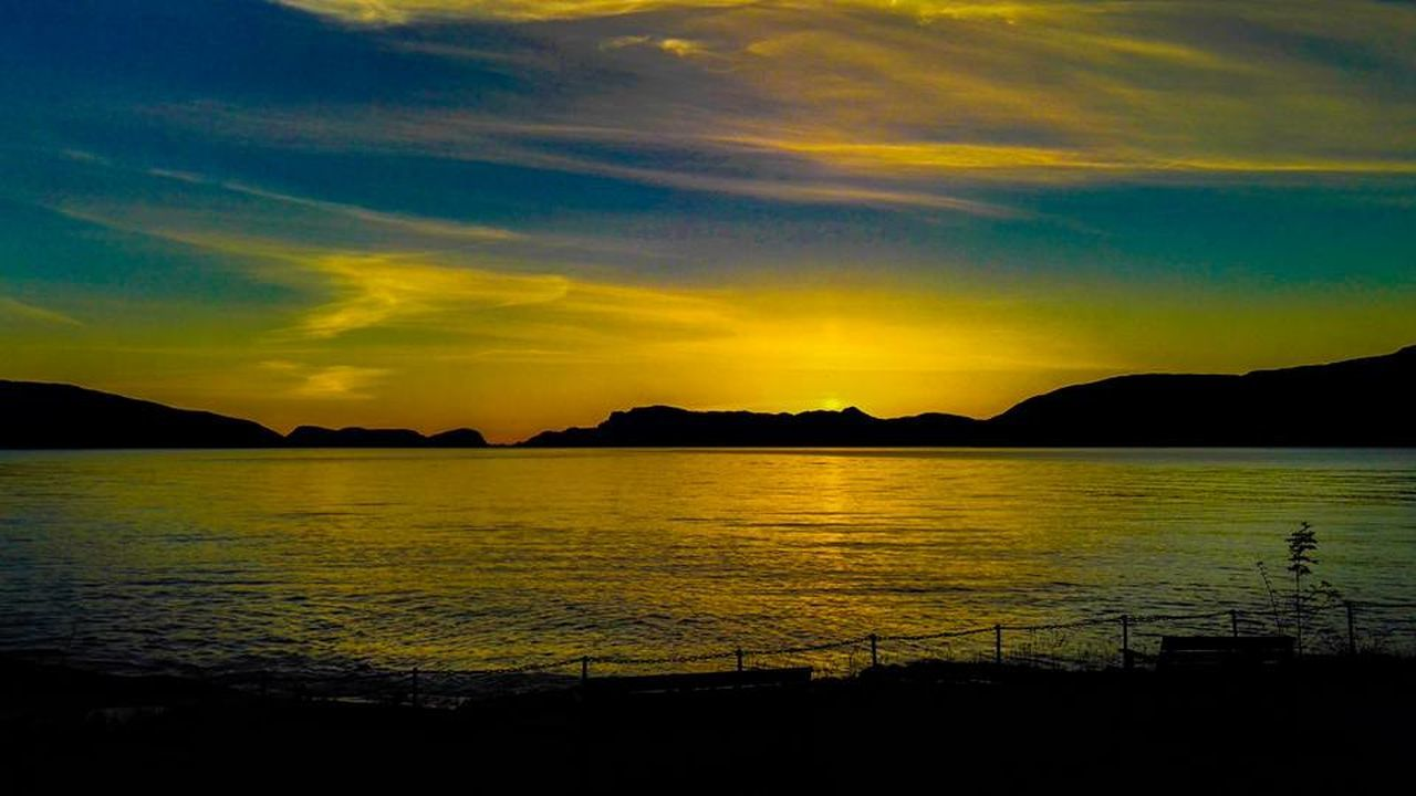 sunset, silhouette, scenics, nature, tranquil scene, beauty in nature, dramatic sky, tranquility, sea, sky, water, outdoors, mountain, cloud - sky, no people, night, bird