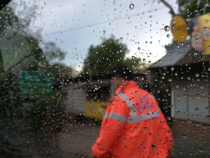 """Duty"". Philippines Rain Duty Work Day Raindrops Raindropsoncarwindow EyeEmNewHere EyeemPhilippines EyeEmPhilippinesalbum Philippines Street Streetscene People Photooftheday Mobile Photography"