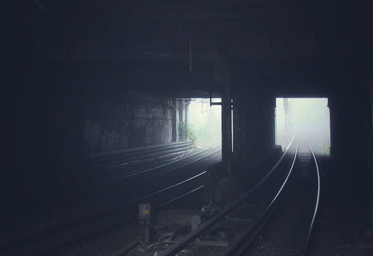 View of railway tracks through fog