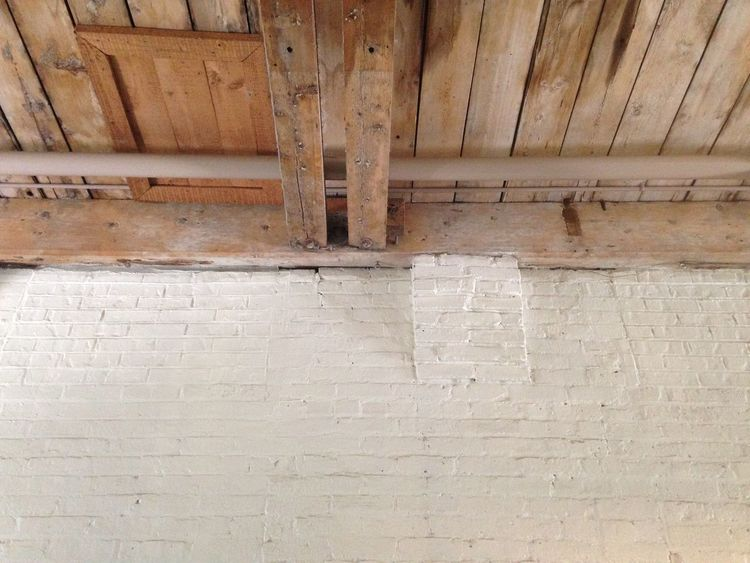 Brick wall against wooden beams on ceiling. Architecture Backgrounds Brick Wall Built Structure Close-up Day Detail Full Frame No People Old Outdoors Repetition Wall - Building Feature
