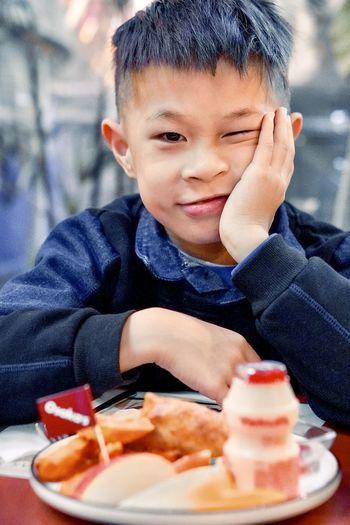 Close-up of boy eating food at restaurant