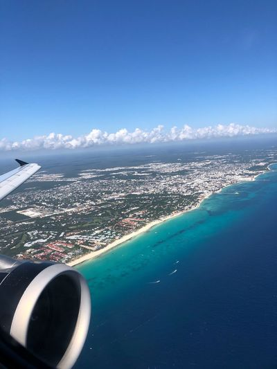 Flying over Cancún Water Sky Sea Blue Nature Air Vehicle Scenics - Nature Airplane Transportation Beauty In Nature Day Land No People Cloud - Sky Beach Travel Mode Of Transportation Copy Space Outdoors Luxury