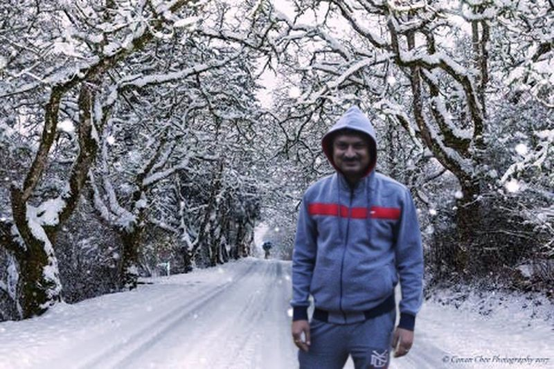 Enjoying snowfall Snowing Day Snowing Snow Covered Snow Snowfalling Snowfall Enjoying Life Enjoying Holiday Holiday One Person Winter Front View Cold Temperature One Man Only Snow Only Men Tree Nature Walking Adults Only Outdoors Adult Young Adult Men Road Young Men Day Standing One Young Man Only
